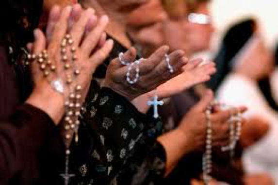 People Praying and Holding Rosaries
